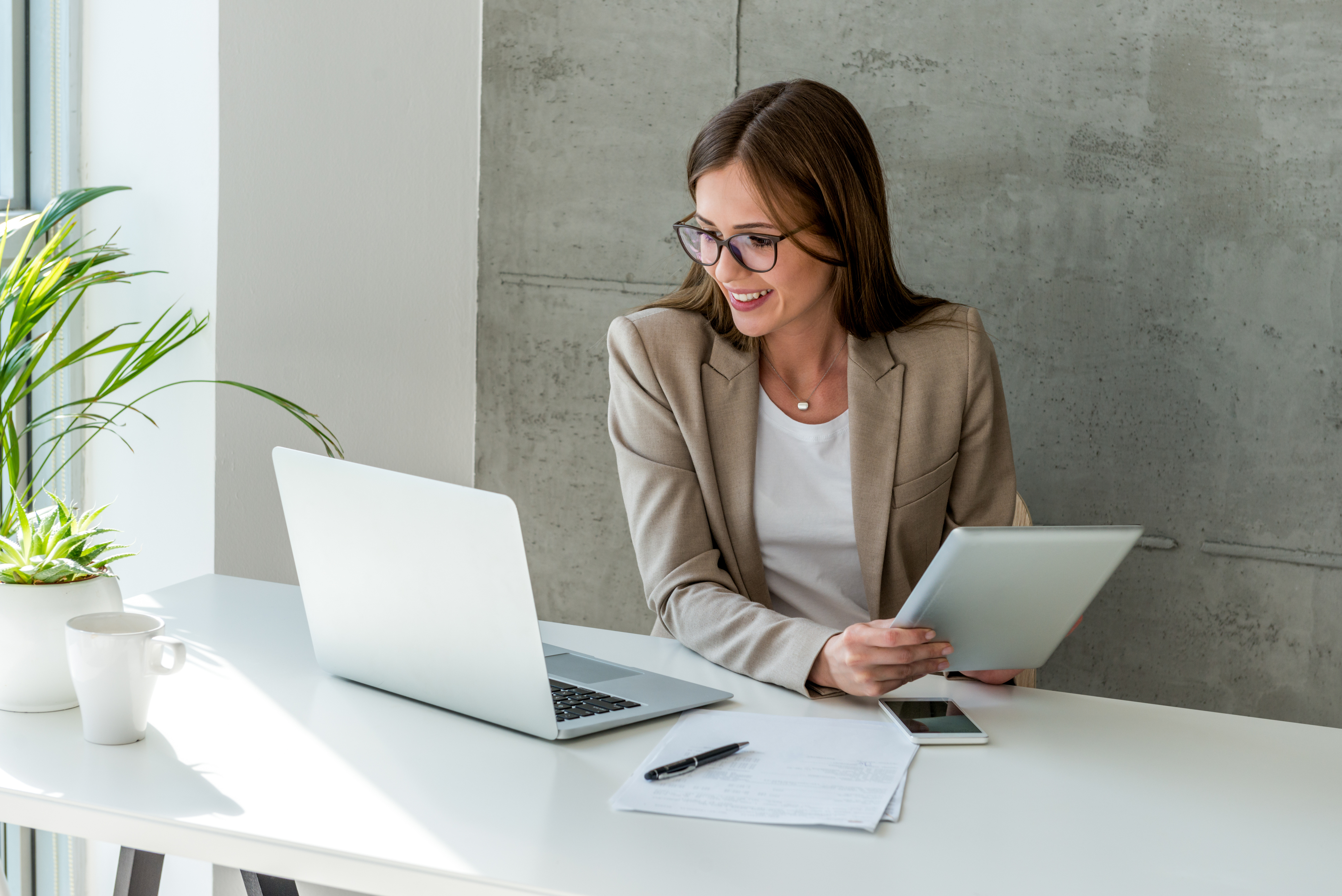 woman looking at data on laptop