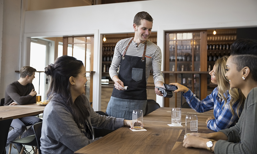 image of restaurant server taking a receipt for an unusual employee expense
