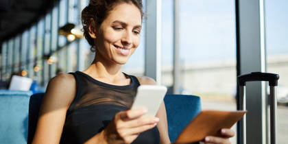 Woman submitting expense report on phone